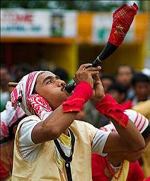 A Bihu Dancer blowing a Pepa
