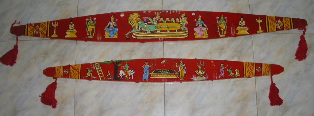 Onavillu decorated with painting of Lord Padmanabha (top) and Krishnaleela (bottom)