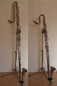 A contra-alto clarinet (right) compared to a contrabass clarinet (left).  None of these instruments saw widespread use, but they provided a basis for contrabass clarinets made beginning in the late 19th and early 20th centuries by several manufacturers, notably those designed by Charles Houvenaghel for Leblanc, which were more successful. Contra-alto