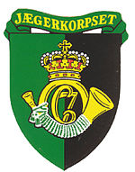 "A hunting horn on the insignia of the Danish ""Huntsmen Corps"" (Jægerkorpset)"