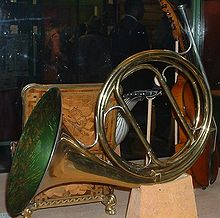 A natural horn has no valves, but can be tuned to a different key by inserting different tubing, as during a rest period.