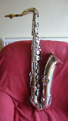 "A silver-plated Conn 'New Wonder' Series II tenor saxophone, with a serial number which dates manufacture to 1934. It is a very late ""Transitional"" model tenor sax with split bell-keys, and was manufactured just before production of the Conn 10M started. Leon ""Chu"" Berry played a tenor saxophone which was very similar to this instrument."